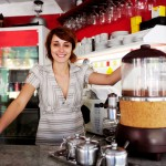Happy Coffee Shop Owner Likes Access to Cash Advance Program
